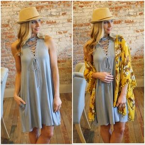 Blue vintage wash lace up dress with pockets